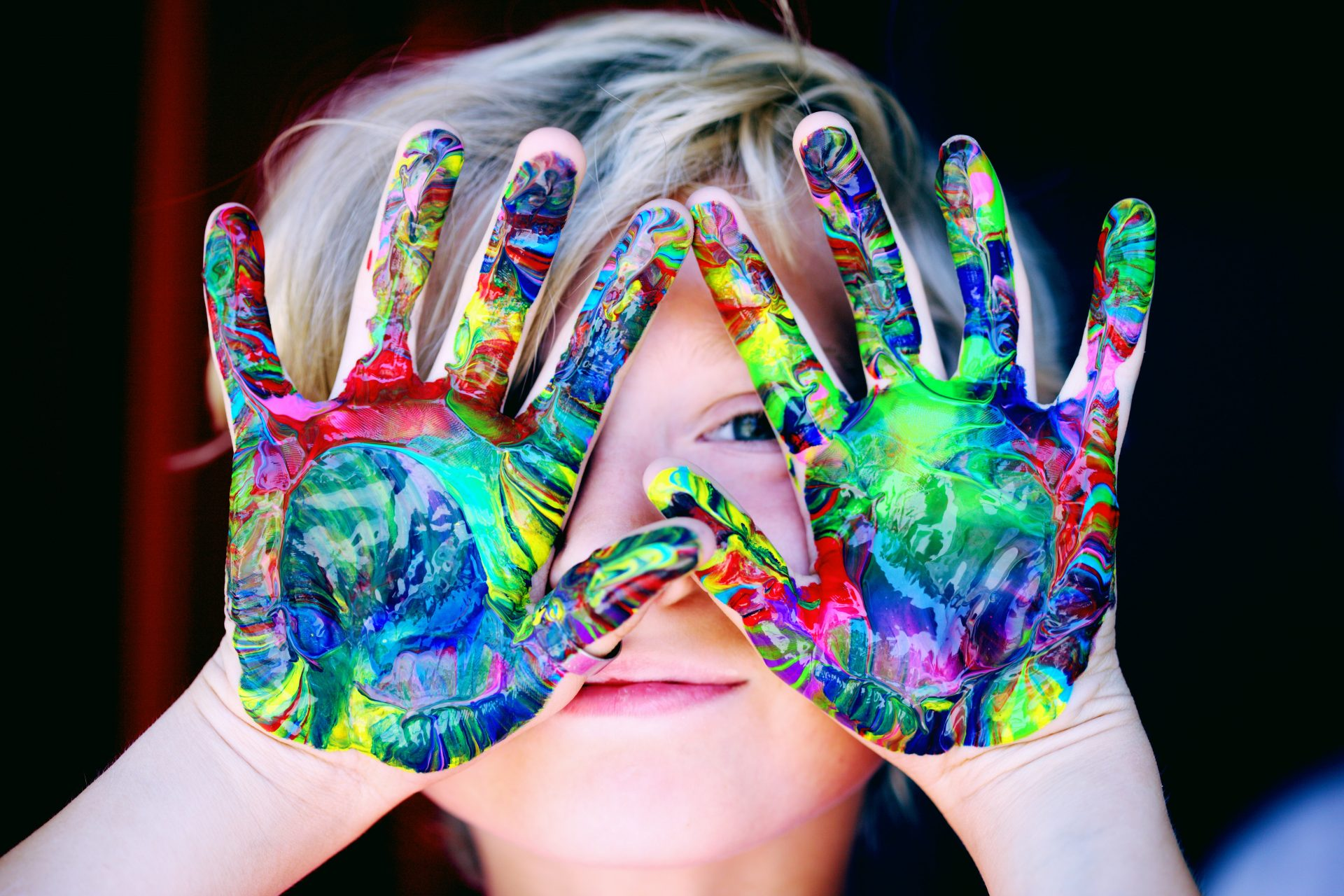 boy with painted hands