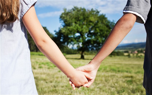 2 people holding hands - how to be a better husband - http://www.dadofdivas.com
