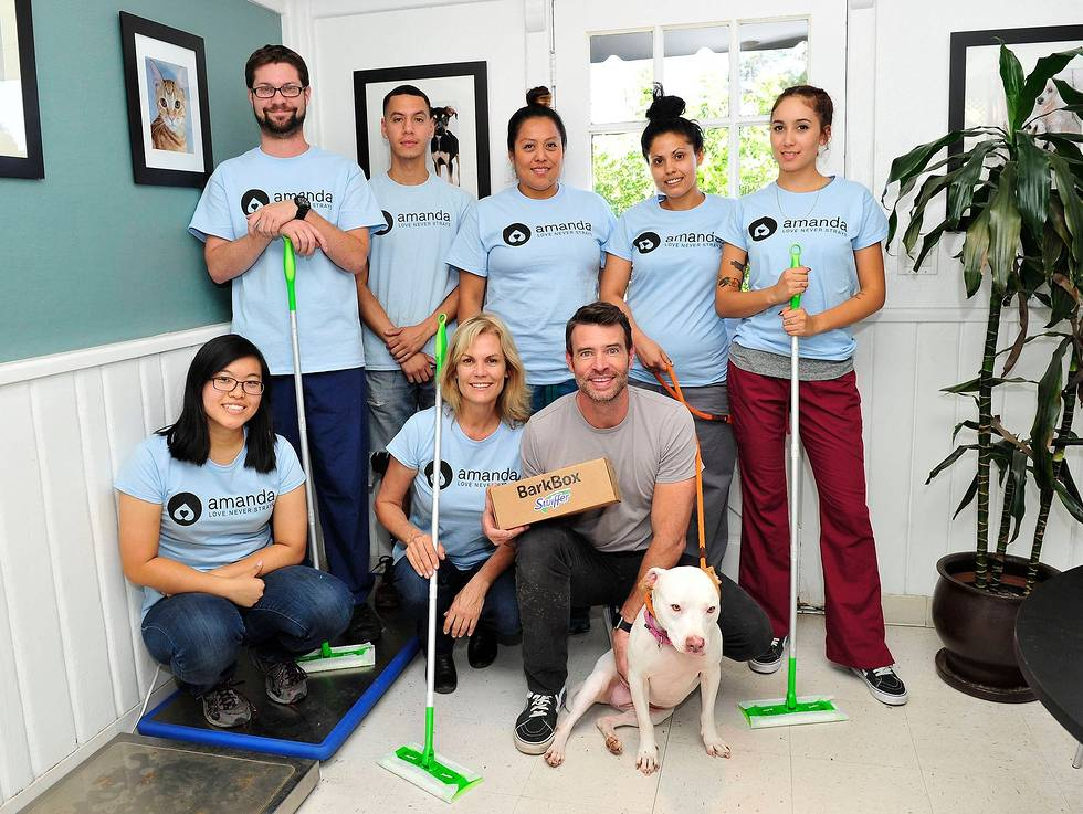 In this image distributed on Thursday, Nov. 12, 2015, Scott Foley delivers the first Swiffer Welcome Home Kit to a local Los Angeles animal shelter. Foley serves as Swiffer campaign ambassador to spread the word that cleaning concerns should never be an obstacle to bringing home your child's first pet.