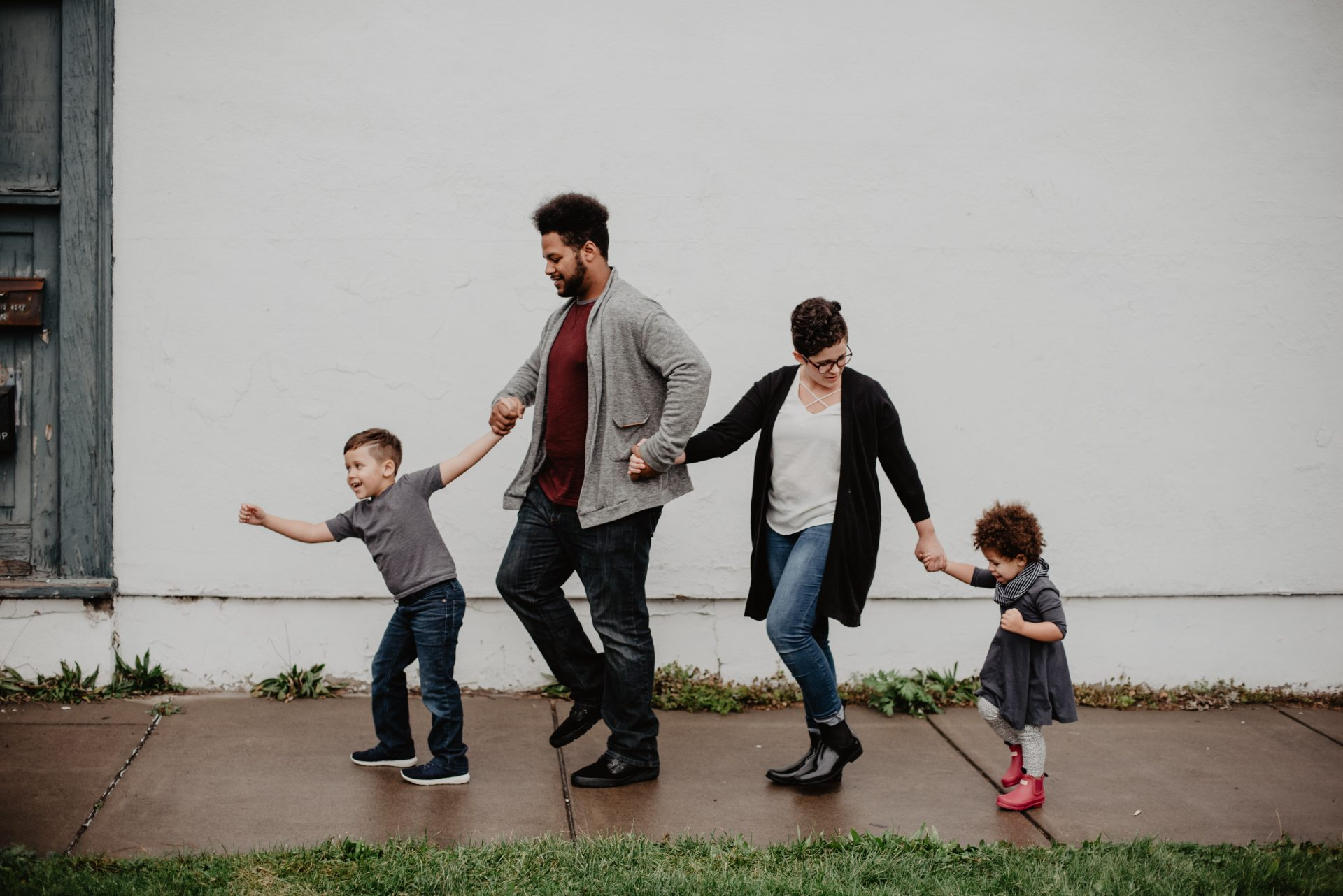 family of four walking on the street